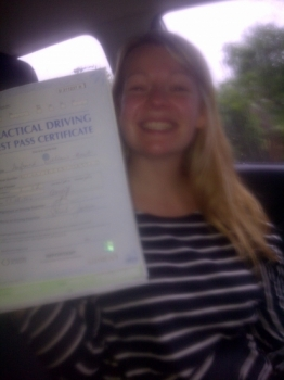 Proudly holding her Pass Certificate. A great drive in heavy rain, hence the picture taken in the car....